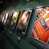 Постеры к фильмам висят на стене
